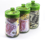 Money in banks. Bills euro and dollars in glass banks on white background Royalty Free Stock Image