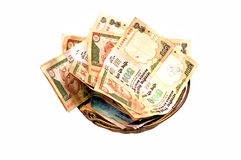 Money in basket Stock Image