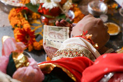 Money being handed over in hindu marriage ceremony. 4th June 2015; Delhi, India: Indian money being handed over in a hindu marriage ceremony by the groom Royalty Free Stock Image