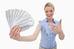Money being held and pointed at by woman Stock Photography