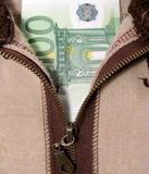 Money below the zipper of sweater Royalty Free Stock Photography