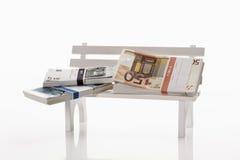 Money on bench Royalty Free Stock Photo