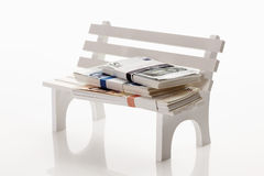 Money on bench Royalty Free Stock Photography