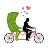 Money for bike. Lovers of cycling. Man rolls dollar on tandem.  Stock Image
