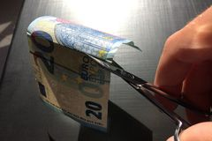 Money bill cuts with scissors, European currency royalty free stock photos