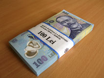 Money bills. Some 100 RON money bills on a table stock images