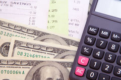 Money, Bills, & Calculator. Some 100 US dollars cash with some bills and a grey calculator Royalty Free Stock Photography