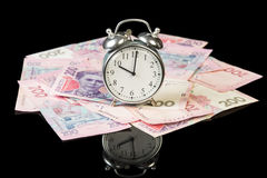 Money bills with clock Royalty Free Stock Photos