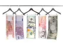 Money bills on clothe hangers. Isolated on a white background. 3d render Royalty Free Stock Images
