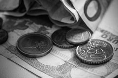 Money bills and coins black and white photography. Stock Images