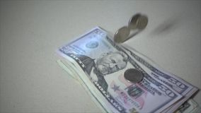 Money bills and coins fall in super slow motion. Shot of Money bills and coins fall in super slow motion stock footage