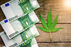 Money with marijuana leaf Stock Photos