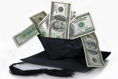 Money in black graduation cap Royalty Free Stock Photos