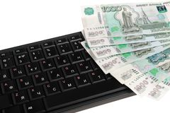 Money on black keyboard isolated on white Stock Photography