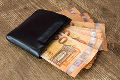 Money in black leather wallet Stock Image