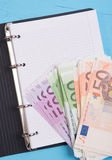 Money and blank notepad Stock Images