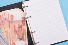 Money and blank notepad Royalty Free Stock Photos