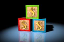 Money blocks. Wooden playing block with golden dollar symbols on them Stock Photos