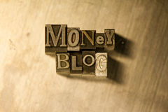 Money blog - Metal letterpress lettering sign. Lead metal 'Money blog' typography text on wooden background Royalty Free Stock Image