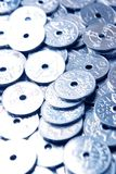 Money in blue. Closeup of coins (Norwegian) with a blue color Royalty Free Stock Images