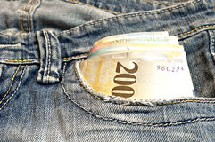 Money in blue jeans Stock Photography