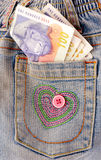 Money in blue jeans Royalty Free Stock Photos