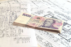 Money on blueprints Stock Photo