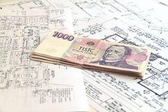 Money on blueprints stock photo
