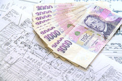 Money on blueprints Royalty Free Stock Images