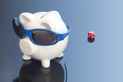 Money Blues. Concept shot of a piggy bank with sunglasses looking like its taking a holiday Stock Images
