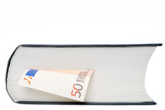 Money in book. Euro banknote between sheets of book isolated on white background Stock Photography