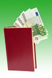 Money in book, isolated Royalty Free Stock Image