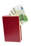 Money in book, isolated Stock Photo