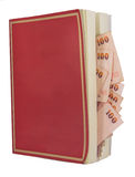 Money in a book, isolated on white background Stock Image