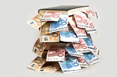 Money in books Royalty Free Stock Photo
