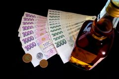 Money and bottle Royalty Free Stock Image