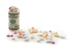 Money bottle full of pills Royalty Free Stock Photo