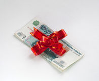 Money and bow Royalty Free Stock Photos