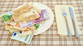 Money Bowl. Plato for money, square tablecloth Stock Photo