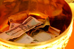 Money in the bowl Stock Image