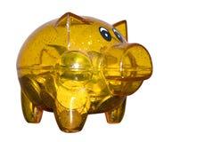 Money Box. Transparent yellow  Piggybank on a white isolated background Royalty Free Stock Image