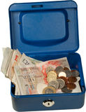 Money box. Blue money box isolated with uk currency Royalty Free Stock Images
