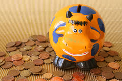 Money Box. In the shape of an orange cow Royalty Free Stock Photos