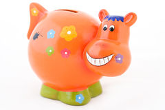 Money box. Orange clay moneybox cow smiling without a background Stock Photography