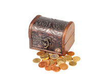 Money box. A brown chest with some coins royalty free stock image