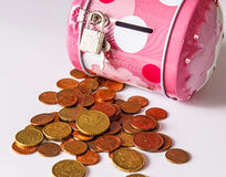 Money Box. And coins on isolation white background Royalty Free Stock Photography