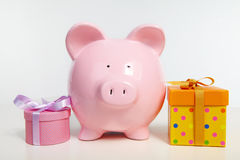 Money-box and fancy boxs Royalty Free Stock Photography