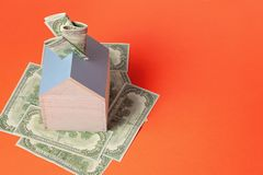 Money box full of dollars. Savings, credit, investments concept stock photography