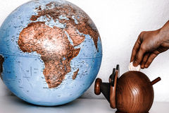 Money box with globe of world Stock Photos