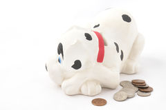 Money box and loose coins Stock Photography